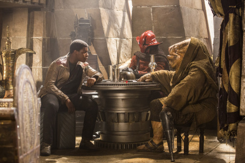 Star Wars: The Force Awakens L to R: Finn (John Boyega), Captain Ithano, and Quiggold. Ph: David James ©Lucasfilm 2015